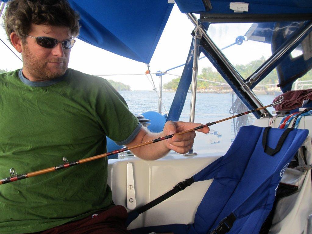 Fixing the fishing pole Capt. Tom gave us