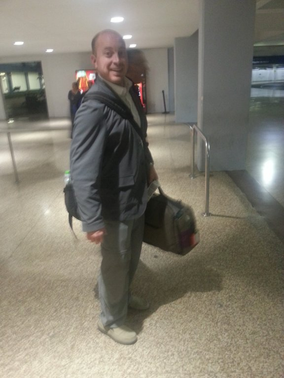 alex arrives with luggage