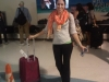 Sara arrives with luggage